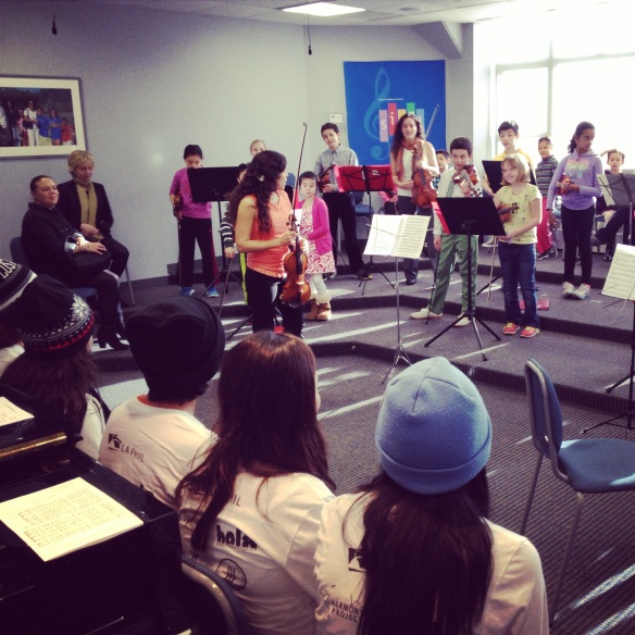 YOLA musicians look on as Boston String Academy musicians perform Vivaldi for them.