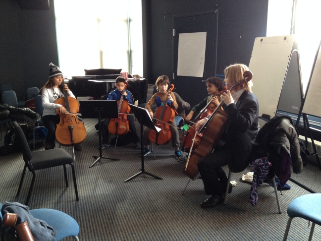 Cellist Heaven Aguilar helping mentor young cellists at the Boston String Academy, one of eight El Sistema USA nucleos in Boston.