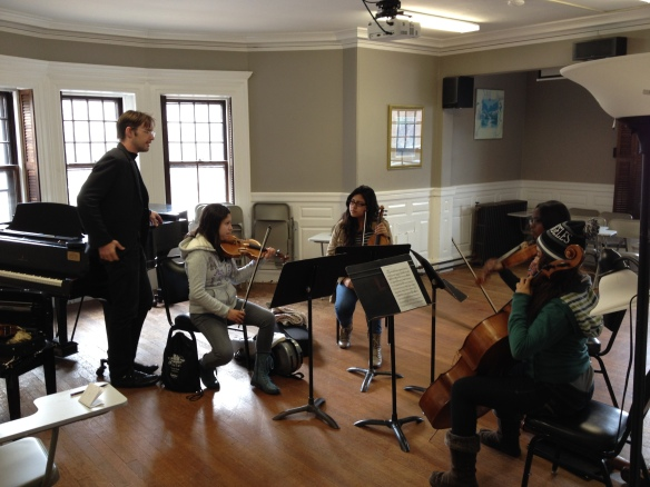 YOLA musicians Arlette Romero (violin), Laura Garcia (violin), Jammaiya Penn (viola), and Heaven Aguilar (cello) receiving a master class at the Longy School of Music in Cambridge.