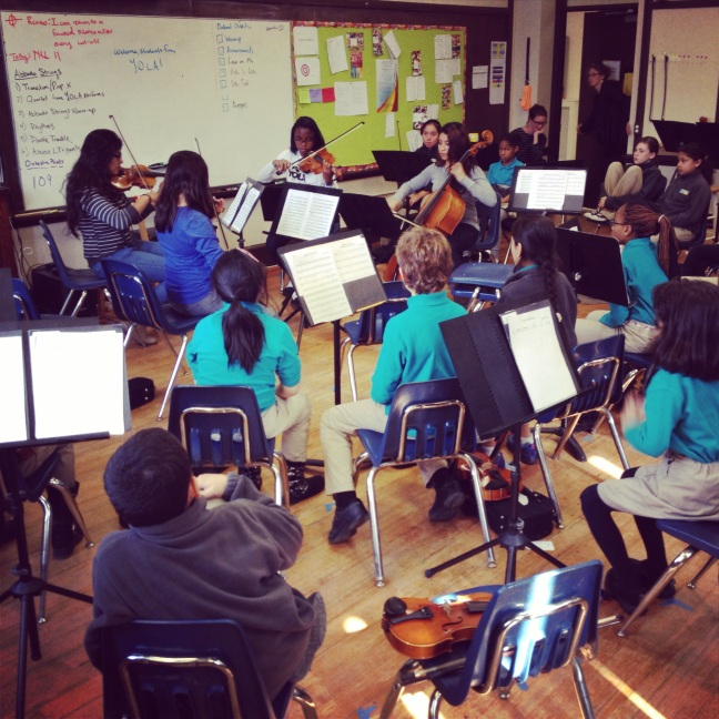 "YOLA musicians Arlette Romero, Laura Garcia, Jammaiya Penn, and Heaven Aguilar performing for the ""Abbado Orchestra"" at the Conservatory Lab Charter School."