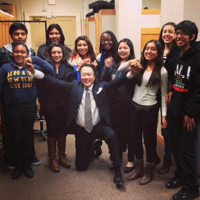 Following his recital at Boston's Symphony Hall, Yo-Yo Ma poses with YOLA musicians backstage.