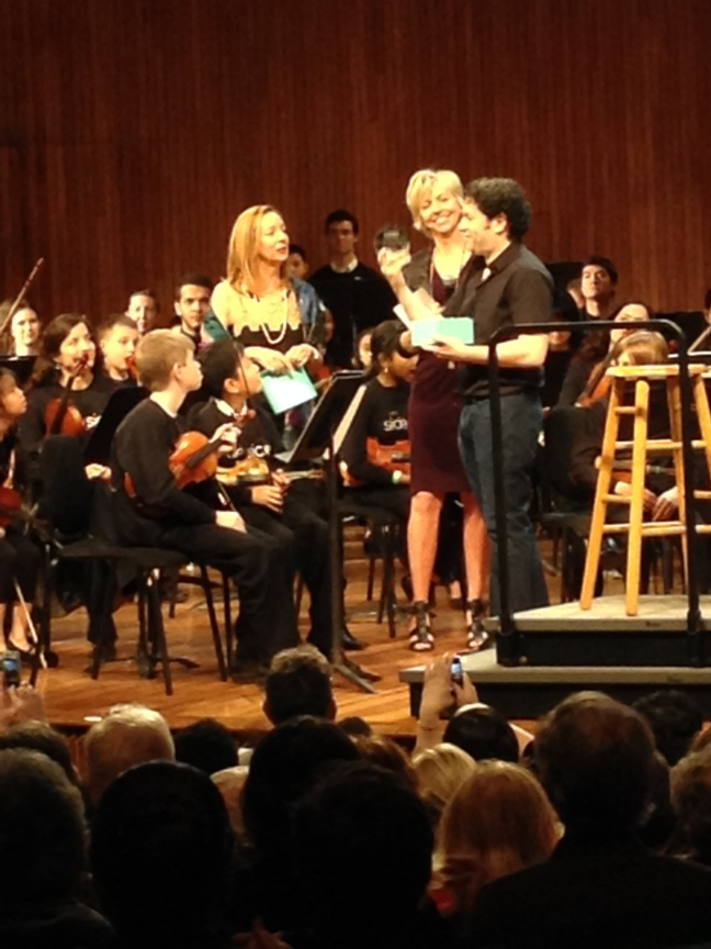 Gustavo Dudamel receiving the Bernstein Lifetime Achievement Award, from Jamie Bernstein (Lenny's daughter) and Longy School of Music president Karen Zorn.