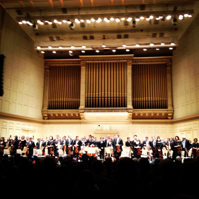 The LA Phil and Gustavo Dudamel, accepting the applause and standing ovation of the Boston Symphony Hall audience, following their performance of Tchaikovsky's 5th Symphony.